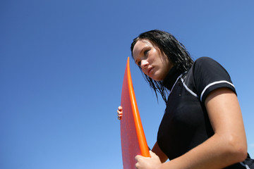Female surfer waiting for the right wave
