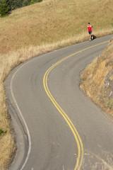 Male runner on winding rural road