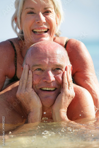 senior couple swimming in the sea