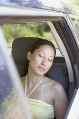 Woman sleeping in passenger seat of SUV