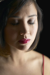 Close up of Asian woman crying