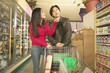 Asian couple shopping in grocery store