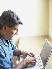 Man working at laptop computer