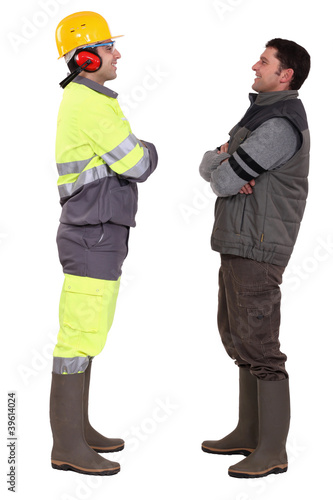 Tradesmen standing face to face