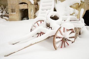 wooden cart under snow