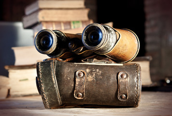 Vintage binoculars on an old map