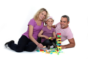 parents playing with their little girl