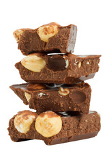 stack of chocolate pieces  with hazelnuts, close up isolated on