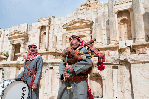 bedouin plays on bagpipes in ancient town Gerasa in Jordan