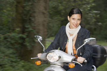 Portrait of woman riding scooter