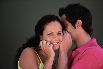 Couple whispering