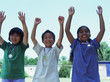 Portrait of children raising hands