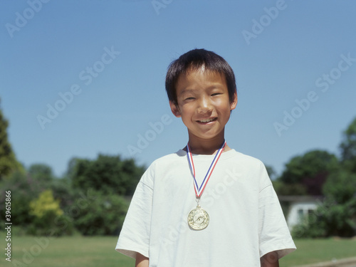 Portrait of boy with metal around neck