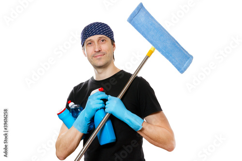 handsome smiling young man with cleaning supplies on white backg