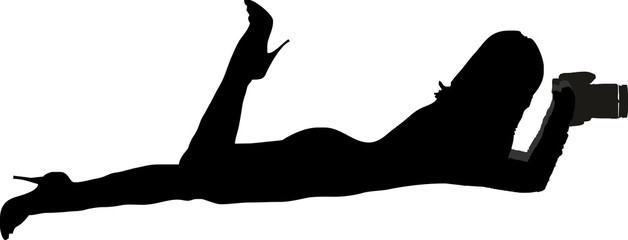 silhouette of a sexy girl lying flat and taking pictures