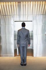 Businessman waiting for elevator
