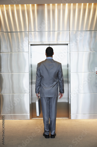 Businessman waiting for elevator