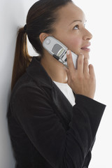 Side view of businesswoman talking on cell phone