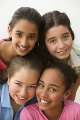 Close up portrait of four girls smiling