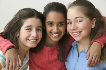 Portrait of three girls smiling