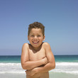 Smiling boy standing on beach