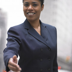 Businesswoman extending hand