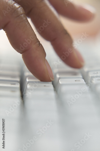 Close up of fingers typing on keyboard