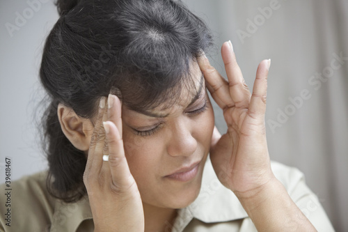 Close up of woman with headache