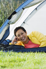 Woman smiling for the camera in a tent