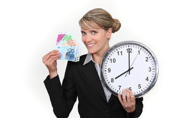 Woman holding clock and bank notes