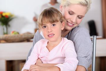 Woman hugging her daughter