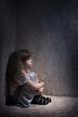 child in a dark corner