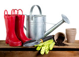Gardening tools and rubber boots