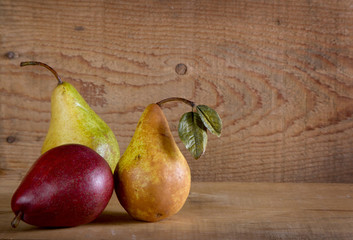 Three pears on a wooden plank