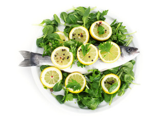 Fresh fish with lemon, parsley and spice