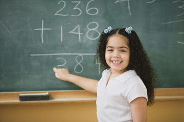 Student doing mathematics on the chalkboard