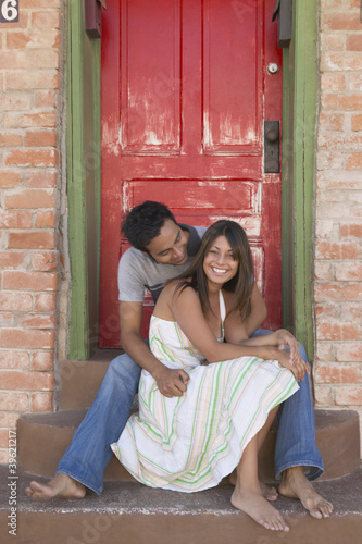 Couple hanging out on a doorstep