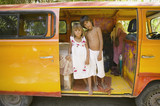 Children posing for the camera inside van