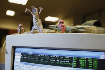 Toys adorning computer screen