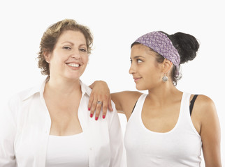 Young woman and her mother posing for the camera