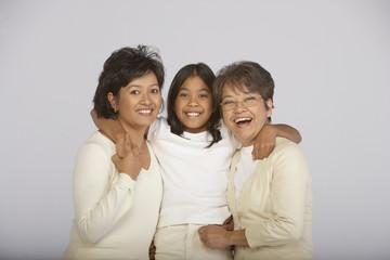 Portrait of female family members hugging