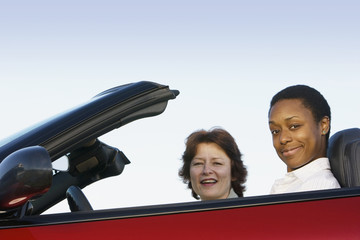 Portrait of two women in convertible