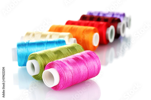 bright bobbin thread isolated on white.