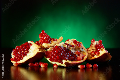 Ripe juicy fruit of the broken pomegranate