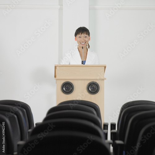 Businesswoman standing at podium