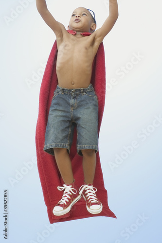 African American boy playing superhero