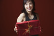 Woman holding gift and smiling