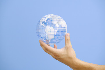 Close up of hand holding globe