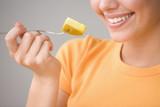 Close up of teenage girl eating fruit