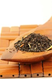 fragrant black tea in wooden spoon